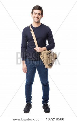 Full length view of a handsome Hispanic university student in a white background