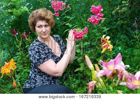 woman with the head facing away from the flowers because of the strong smell