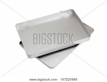 Open flat empty rectangular tin box with removed lid on a light background