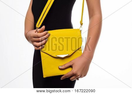 Young Woman Posing In Black Dress And Yellow Bag