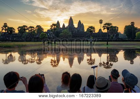 Many Asian Tourists Taking Picture Of Angkor Wat At Sunrise