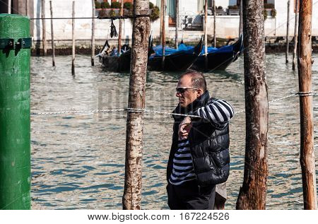 Venice Italy- February 25th 2011: Profile of a gondolier waiting for cliets on The Grand Canal in Venice..