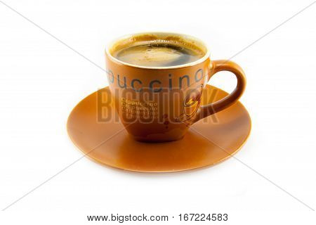 a cup of capuccino on white background isolated