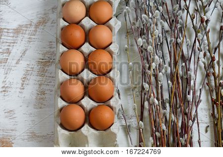 Eggs In A Cardboard Tray And A Bunch Of Pussy-willow Twigs