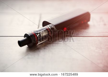 Electric E-cig Vaping Smoking Device On Table