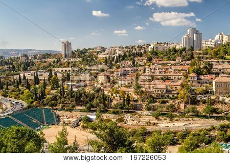 View of Jerusalem and historic neighborhood Yemin Moshe from the wall of the Old City in Jerusalem Israel