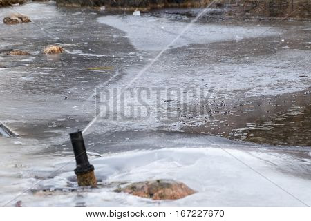 Fountain Gushing On Frozen Pond