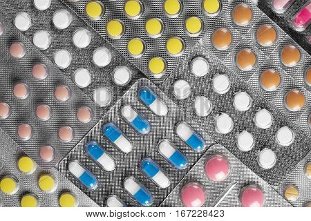 Medical Pills In Different Colors In The Plastic Containers