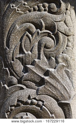 Bas-relief in the form of floral ornament on a stone