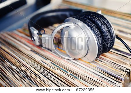 Disc Jockey Head Phones Laying In Vinyl Records With Music