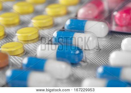 Medical Pills In Different Colors In Plastic Containers