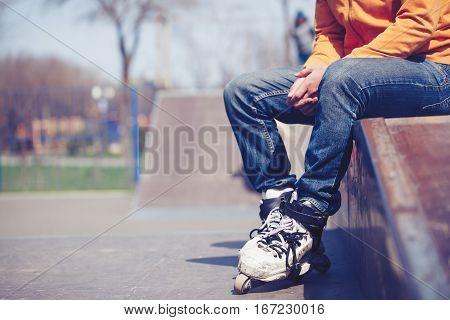 Rollerblader Sitting In Aggressive Inline Skates