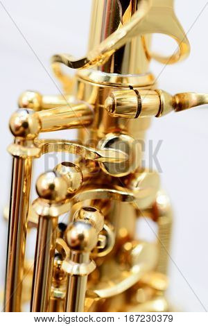 Shiny golden alto saxophone with detailed view of keys