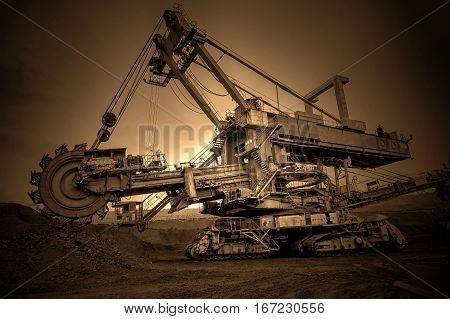 CZECH REPUBLIC, MOST - SEPTEMBER 23, 2015: Giant bucket wheel excavator, coal mine, sunset sky