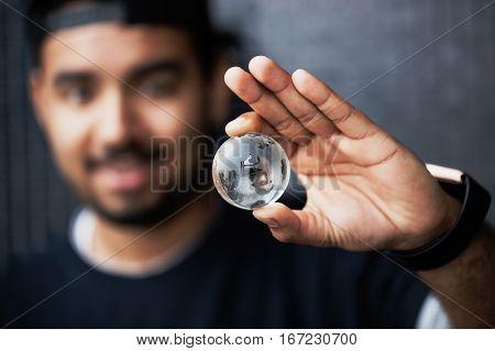 Black Man Holding Glass Globe Eearth Model