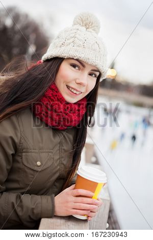 Young Girl Drink Coffee Outdoor In Winter