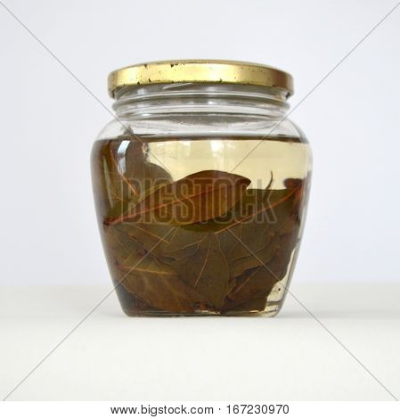 Tincture with bay leaves in a jar