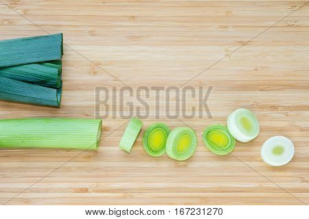 closeup of chopped leek on chopping board with copy space