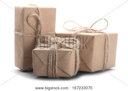 Boxes With Gift Wrapped In Kraft Paper On Isolated White Background