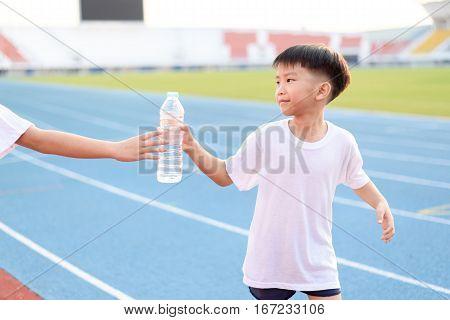 Running Boy Take Water