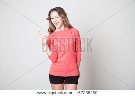 beautiful girl shows hands symbol OK 1