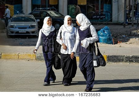 Hurghada, Egypt - November 7. 2006: Schoolgirls of the senior classes come back home from school