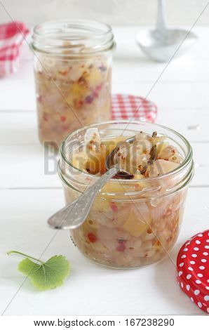 home made chutney with white currants, apple, onion and pink pepper kernels