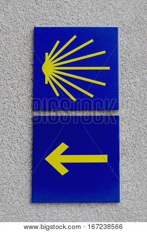Camino De Santiago Waymarkers Scallop Shell And Yellow Arrow
