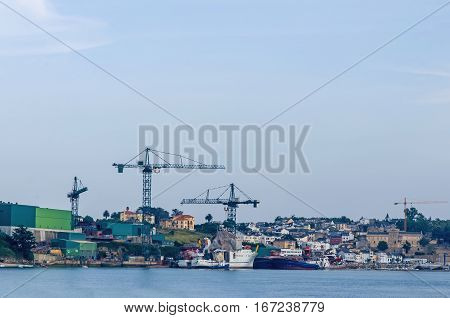 Detail of a shipyard with some boats in maintenace and repair works. Heavy industries