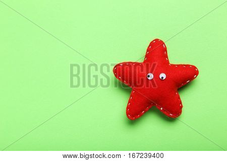 Decoration Star With Googly Eyes On A Green Background