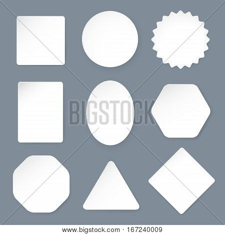 White paper labels on a gray background. Set of labels of various shapes: square, circle, star, oval, rectangle, polygon. Vector illustration in a realistic style.