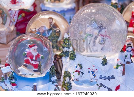 snow globe with surfin' santa claus on a market