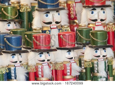wooden nutcracker army displayed on a christmas market