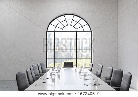 Meeting room interior. There is a long table with glasses with chairs around it. An arc shaped window is in a concrete wall. 3d rendering.