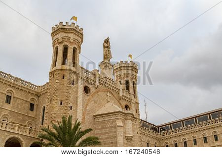 Facade of Notre Dame de Jerusalem with statue of the Virgin Mary with Child Jesus Notre Dame de France Catholic monastery and guesthouse in Jerusalem Israel