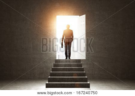 Pathway of opportunity. Back view of man exiting concrete room with stairs to enter open door with bright city view. Success concept
