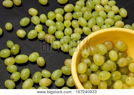 Juicy Grapes On A Black Background