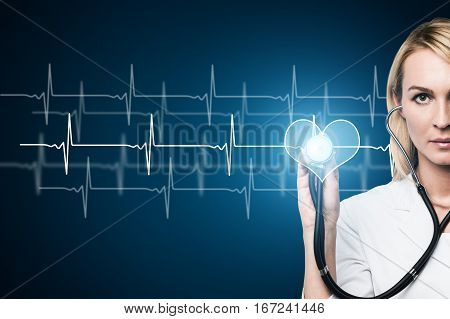 Attractive concentrated female doctor checking heart beat. Healthy heartbeat chart. Medicine and health concept