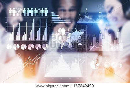 Abstract image of blurry businesspeople at a meeting discussing business figures. Teamwork concept