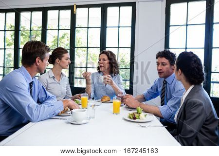 Business people discussion during a business lunch at restaurant