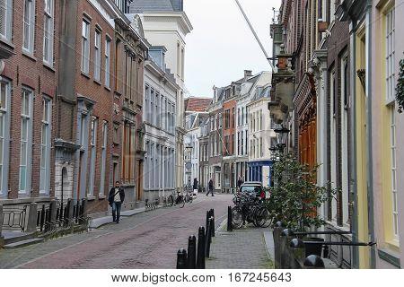Utrecht the Netherlands - February 13 2016: People walking along the street in historic centre of Utrecht the Netherlands