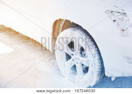 car getting a wash with soap background