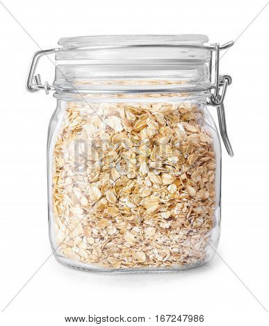transparent glass jar with rolled oats isolated on white background with clipping path. Glass jar with oatmeal flakes. Dry, uncooked oat flakes