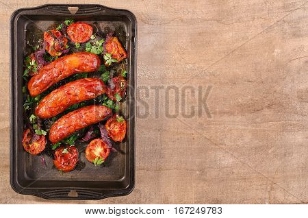 Sausage. Delicious Sausages In A Pan With Tomato. Salad.