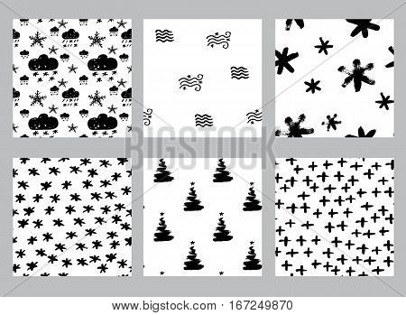 Vector collection of seamless hand drawn patterns. Winter weather theme. Made with ink. Set of black and white patterns for fabric polygraphy web game design.