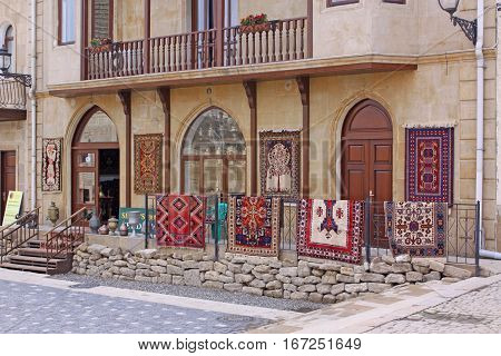 Azerbaijan. Baku. Shop of Souvenirs and carpets in the old town. poster