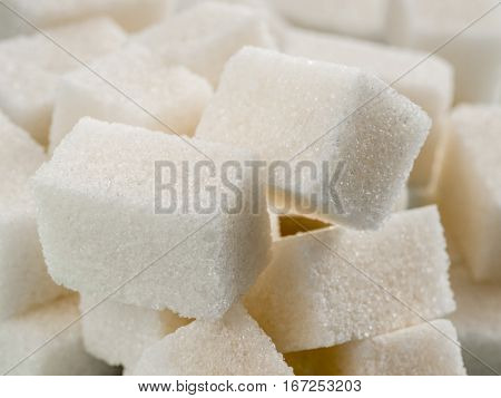 Background of sugar cubes. White cube sugar close up as food background