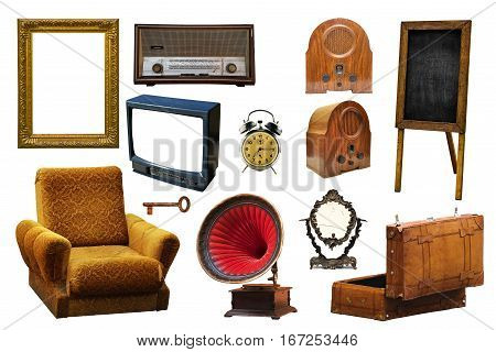 Collection of vintage retro home related objects isolated on white background - picture frame radio device armchair gramophone key mirror leather suitcase alarm clock information board and tv set.