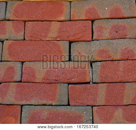 Pointing Brick Wall Copy Space. Bright Studio Closeup on Colorful Red Old Luxury Ceramic Clinker Brick Textured Wall Background with Copyspace.