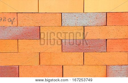 Pointing Brick Wall Copy Space. Bright Studio Closeup on Colorful Modern Orange Luxury Ceramic Clinker Brick Textured Wall Background with Copyspace.